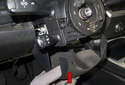 Pull the steering column trim down to remove (red arrow).