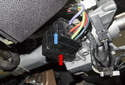 Ignition Electrical Switch: Pull the electrical connector (red arrow) release lever (blue arrow) out to disconnect it.