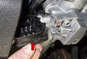 Once the screws are removed, slide the ignition switch out of the steering column.