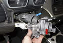 Now you can install the new steering column lock (red arrow) onto the steering column (blue arrow), without the steering shaft.