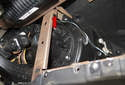 Working near the blower motor, remove the 10mm fastener for the instrument panel support (red arrow).