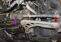This photo shows the power steering rack (purple arrow) and the tie rod end (red arrow).