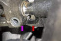 Later, when reinstalling the steering shaft, be sure to align the split in the shaft coupler (purple arrow) with the plastic tab (red arrow) on the rack.