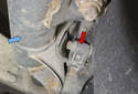 Front sensor: The front wheel speed sensor is mounted in the spindle (red arrow), between the strut (blue arrow) and the wheel hub.