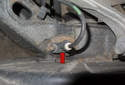 Rear sensor: The rear sensor in mounted in the rear swing arm behind the brake rotor backing plate (red arrow).