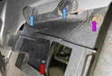 Rear sensor: Remove the 8mm fastener (purple arrow).