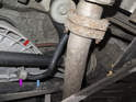 Rear sway bar links: The rear sway bar link (purple arrow) connects the rear swing arm (red arrow) to the sway bar (blue arrow).