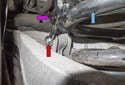 Rear sway bar links: Working at the end link behind the coil spring, loosen the 13mm end link nut (red arrow) while counter-holding the ball joint with a 13mm wrench (purple arrow).