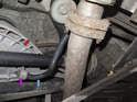 Rear: The rear sway bar link (purple arrow) connects the rear swing arm (red arrow) to the sway bar (blue arrow).