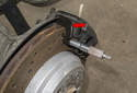 Lift the axle of the vehicle you are measuring brake rotors on.