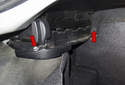To replace the stowage base adjusters, start by removing the two 10mm fasteners (red arrows).