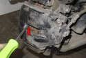 Using a flathead screwdriver, slowly press brake caliper piston in.