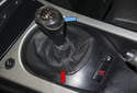 The shift boot (red arrow) or shift knob (blue arrow) can dry rot and wear out over time, leaving a less than desirable interior appearance.