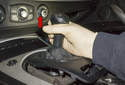 Next, remove shift knob by pulling straight up and off shift lever (red arrow).