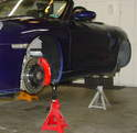 The best place to support Boxster with jack stands is under the factory jack support areas.