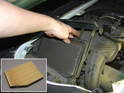 Pull up on the air filter cartridge and remove it from the car.