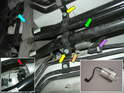 The filter (green arrow) is located almost dead-center in the middle of the car, hidden somewhat behind the coolant pipes.
