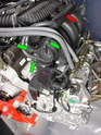 There are a set of hoses that run across the top of the motor and connect to the air/oil separator that are not used with the Boxster.