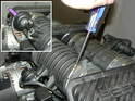 The 996 engine has a resonance flapper valve installed in the rear intake manifold crossover tube.