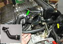 This photo shows the stock configuration of the Carrera 996 throttle body crossover tube and the air-oil separator.