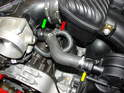 This photo shows the new air-oil separator hose installed.