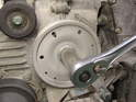 Use a 24mm socket on a large driver to turn the crankshaft over.