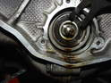 For engines with the single row bearing, the bearing is held in place against the intermediate shaft by a big circlip.