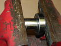 If the center bolt is not pre installed into the bearing, you need to gently press it in.