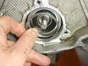 For engines that use the double-row bearing, you install the new bearing, the spacer, and then the Spiroloc circlip.