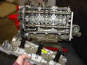 When you remove the camshaft cover, you should see the camshafts and the chains underneath.