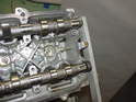With the camshaft caps in place and the tensioner tightened down, affix the camshaft timing tool to the opposite end.
