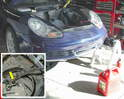 This photo shows a safe method for emptying the gas out of the tank in your Boxster.