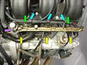 Unplug the wire harness from each injector (yellow arrow).