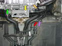 This photo shows the coolant drain plug (yellow arrow), and the hoses that need to be disconnected in order to empty the coolant from the system.