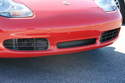 Here's a photo of a Boxster S with the center radiator installed from the factory.