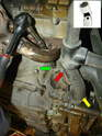 Disconnect the main hose to the thermostat, as indicated by the red arrow.