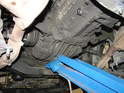With the car raised up on jack stands, take your floor jack and support the transmission from underneath.