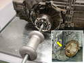 The first step is to remove the halfshafts from the transmission.