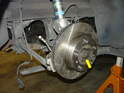 If you are replacing the entire axle, then you need to remove the outer axle nut (yellow arrow).