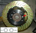 Mount the disc to the hub and temporarily fasten it with the brake disc locating screw (red arrow).