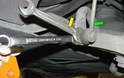 The drop links (green arrow) may present a challenge to remove, as the ball joint on the top of the link may spin when you try to remove the outer nut.