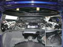 Shown here is a great-looking carbon-fiber strut bar that extends across the rear of the battery.