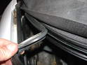Reinstall the rear weatherstripping into the middle channel.