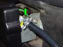Release the cables from the motor by sliding the metal retaining clip (yellow arrow) up off of the cable (green arrows).
