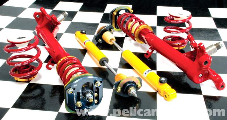 Better coil-overs such as these from Ground Control use modified factory strut housings to increase travel on lowered cars.