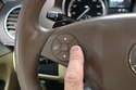 Press the button at the three o'clock position on the left side of the steering wheel.