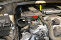 Pull the hose from the air pump off the right side of the rear engine cover (red arrow).