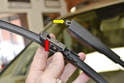 You can see how the blade cartridge or mount opening (red arrow) sits in the arm opening (yellow arrow) and then pivots back down to lock in place.