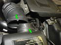 Note the tab on the upper air hose and the notch on the air filter housing (green arrows) when installed, the tab fits into the notch.