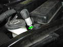 Remove the plastic pin securing the washer fluid reservoir to the lock carrier.